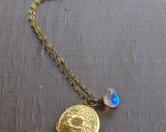 SALE NIGHT BLOSSOM. Antiqued brass locket Necklace and aurora borealis crystal onion briolette