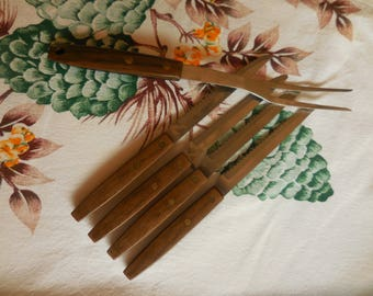 Four Steak Knives and a Steak Fork Mid Century
