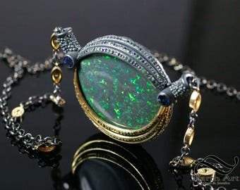 The Australian Eye - Andamooka Matrix Opal in 18k yellow gold and Sterling