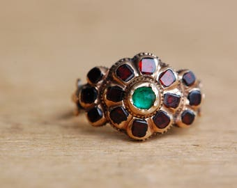 Antique Baroque 18th century Iberian garnet ring with emerald center