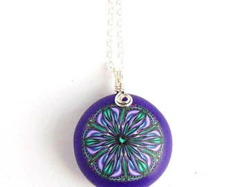 Small Purple Pebble Pendant with Intricate Lilac Millefiori Flower Design, Sterling Silver Chain. Handmade by Supremily Jewellery