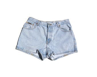 "CK shorties | Calvin Klein light wash denim jeans 90s vintage short shorts 30"" waist womens high waist large L 9 10 12"