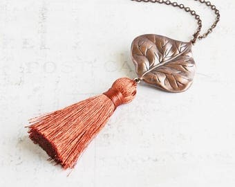 Rusty Orange Tassel Pendant Necklace with Antiqued Copper Leaf