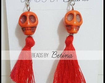 BEE//SUGAR: Skull & Tassel Earrings in Orange/Red