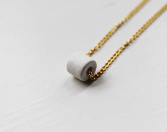 the Santorini -necklace (white ceramic bead and gold plated chain minimal discreet neckpiece)
