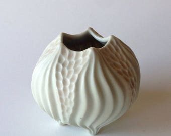 Carved porcelain yellow and orange squat vase