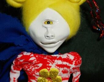 art doll, weird, one eyed,