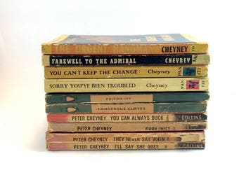 Set of ten vintage 40s and 50s Peter Cheyney mass market paperbacks. Collins White Circle. Penguin. Pan Books. Pulp cover art.