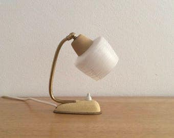 Beautiful small mid-century modern table lamp, bedside lamp, accent lamp. Frosted glass shade, gold (brass) details, yellow ochre base.