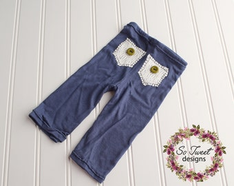 Puppy Dog Tails - newborn pants in a navy blue knit with white textured pockets and olive green buttons (RTS)