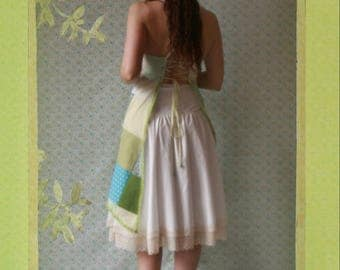 apron patchwork in shades of green, blue and white patterns