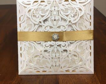 Ivory shimmer wedding invitation set: kit includes shimmer laser cut pocket, ribbon, charm, printed invite, gold mirror backer & envelope