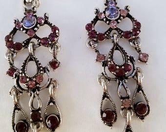 Pink stone chandelier earrings.