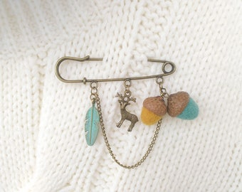 Safety pin brooch with two needle felted acorns, Felted acorn, Dangle brooch with charms, Deer brooch, Kilt pin, Feather jewelry, Charm pin