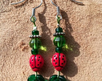 Ladybird and leaf earrings.