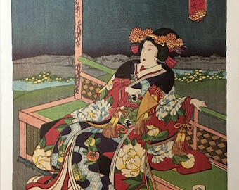 A modern lithograph of a Japanese woodblock print of a seated woman.
