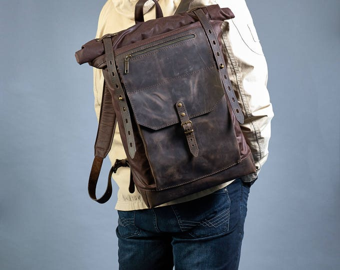 Dark brown roll-top backpack. British waxed canvas, crazy horse leather.