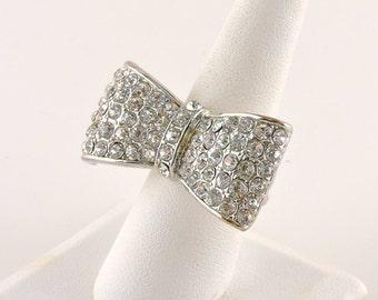 Size 8 Silver Tone Stretchy Band Rhinestone Bow Tie Ring
