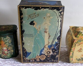 Vintage Art Deco Candy Tin Box Fides Assorted Chocolates with Pretty Lady and Cupid in Garden Advertising Chocolate Products Baltimore 8463