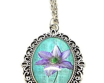Collier mi long cabochon glass purple flower on turquoise background