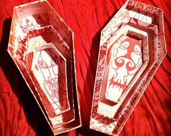 Coffin Boxes-Nesting Coffins in Red with surprise shrink plastic charm