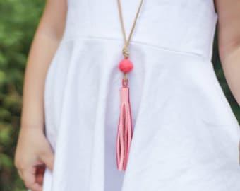 Girls bright pink leather tassel necklace with medium wool felt pom