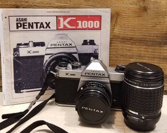 Pentax K1000 Full Kit - works great (includes battery, 2 lenses, camera strap, manual copy, and 2 lens caps)