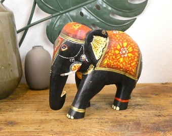 Painted and carved wooden elephant figurine