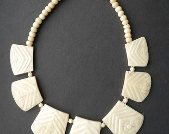 Carved bovine bone choker necklace with flowers