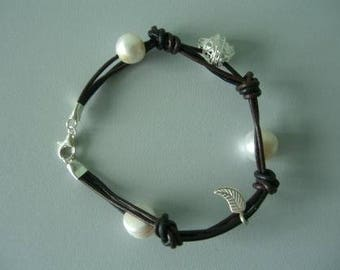 Charm Bracelet - . Leather strap. Silver charms and Freshwater Pearls.