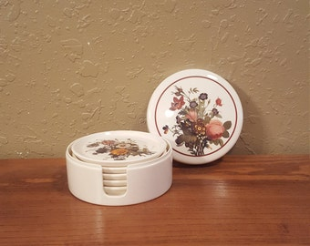 Set of 5 vintage melamine coasters with caddy.  Vintage round floral coasters in coaster case.