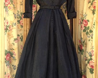 "1950's, 36"" bust, black moire dress with attached net petticoat,"