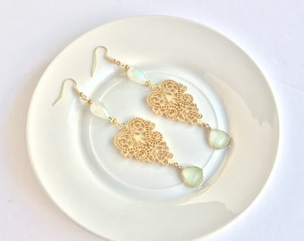 Gold and iridescent statement earrings