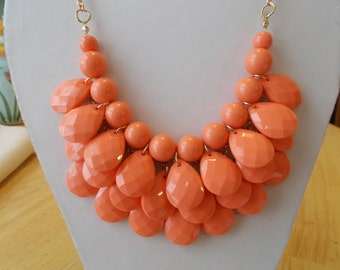 3 Row Bib Necklace with Peach/Orange Teardrop Beads on a Gold Tone Chain