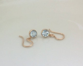 Small blue topaz earrings 14Kt gold filled; blue topaz earrings; gold blue topaz earrings; round blue topaz drop earring; natural blue topaz