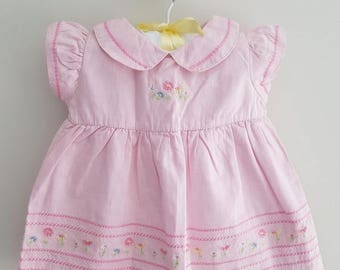Gorgeous pink baby dress with embroidered detail