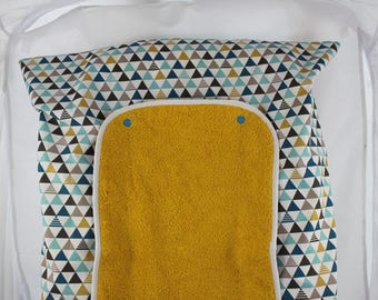Changing mat cover with two mustard and duck blue nappies.