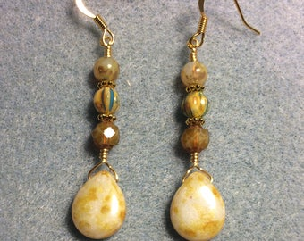 Beige yellow Czech glass pear drop earrings adorned with beige yellow Czech glass beads.
