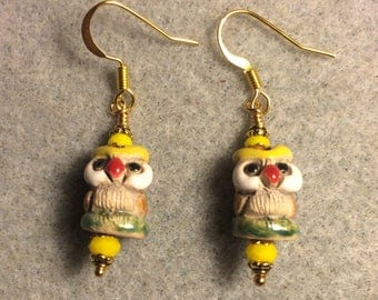 Small tan, yellow and green ceramic owl bead earrings adorned with yellow Chinese crystal beads.