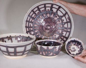 Dots and Window Pane Pattern Graduated Set of Four Stoneware Wheel Thrown and Hand Decorated Bowls