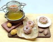 Fried Donuts preparing bo...