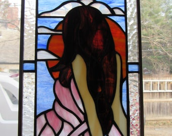 Stained glass girl with sunset