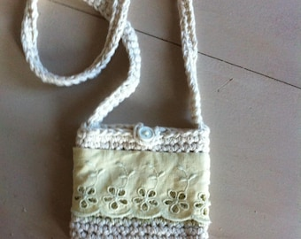 small crocheted purse and broderie anglaise