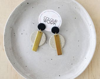 Circle Stick Earrings - Jet Black & Speckled Sand with a brass rectangular bar.