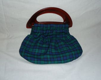 Green and blue tartan bag with plastic handles