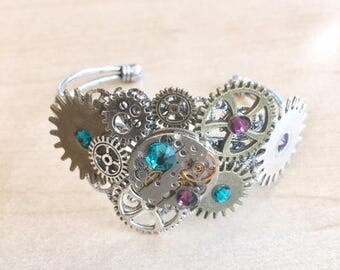 Steampunk silver bracelet with cogs, gears, watch mecanism and purple crystal