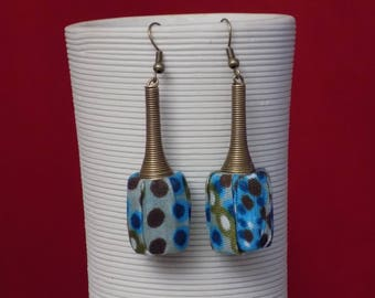 Earring dangle cone and decorated with fabric backing