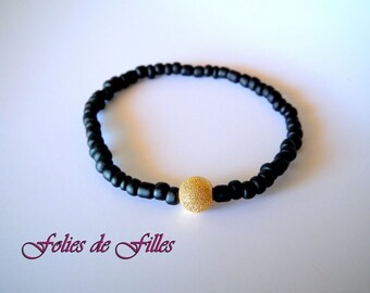 Bracelet black and gold beads