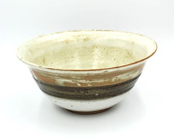 Serving bowl in contrasting earth tones