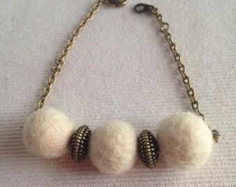 Bracelet of felted wool balls and bronze chain handmade